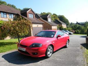 Red Hyundai Coupe